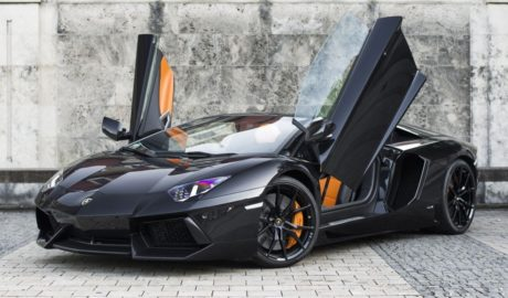 A Lamborghini Aventador Roadster with open doors.