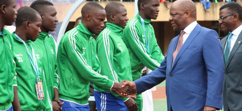 Kabaka greets Buddu players before last years Airtel Masaza Cup final kick off at the Namboole stadium.