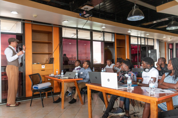 Kelly Davis, Head of Mozilla's Machine Learning Group, explaining the design and technology behind Deep Speech and Common Voice at a Hackathon in Kigali, February 2019